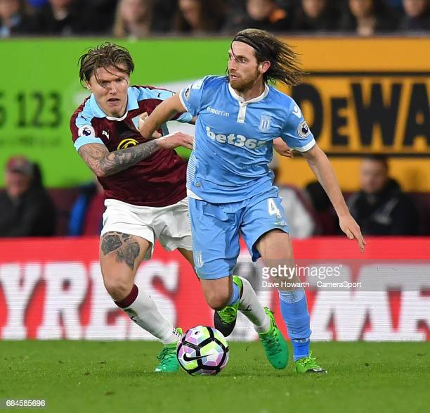 Burnley's Jeff Hendrick battles with Stoke City's Joe Allen during the Premier League match between Burnley and Stoke City at Turf Moor on April 4...
