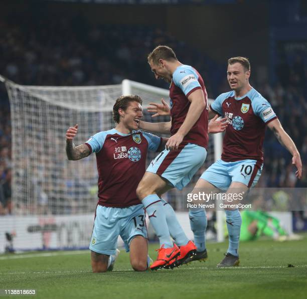 Burnley's Jeff Hendrick celebrates scoring his side's first goal with Chris Wood and Ashley Barnes during the Premier League match between Chelsea FC...