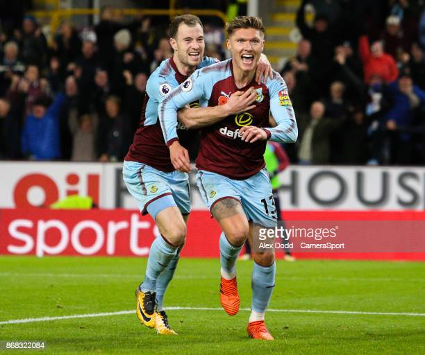 Burnley's Jeff Hendrick celebrates scoring his side's first goal with teammate Ashley Barnes during the Premier League match between Burnley and...