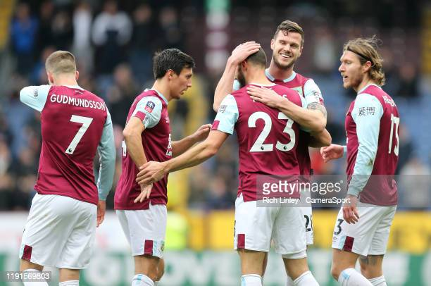 Burnley's Jeff Hendrick is mobbed by team-mates as he celebrates scoring his side's second goal with a shot from long range during the FA Cup Third...