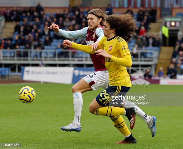 Burnley's Jeff Hendrick vies for possession with Arsenal's Matteo Guendouzi during the Premier League match between Burnley FC and Arsenal FC at Turf...