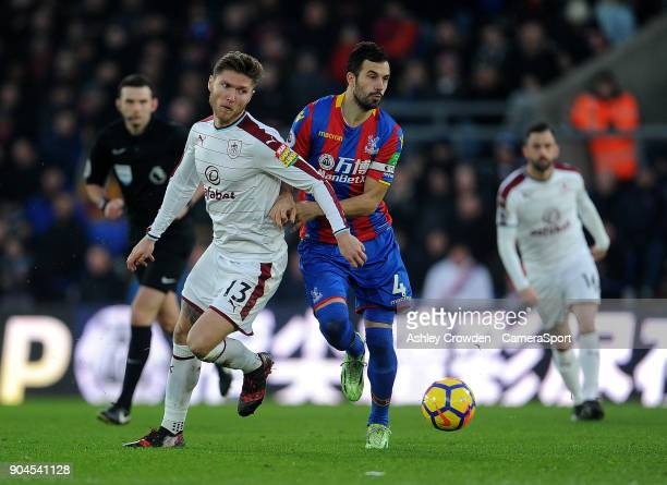Burnley's Jeff Hendrick vies for possession with Crystal Palace's Luka Milivojevic during the Premier League match between Crystal Palace and Burnley...