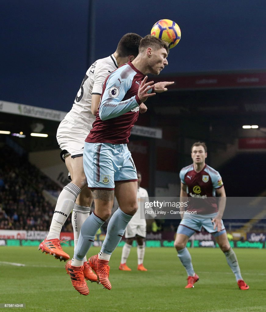 Burnley's Jeff Hendrick wins an aerial ball despite the attentions of Swansea City's Federico Fernandez during the Premier League match between Burnley and Swansea City at Turf Moor on November 18, 2017 in Burnley, England.