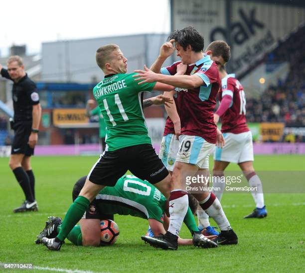 Burnley's Joey Barton appears to push Lincoln City's Terry Hawkridge which resulted in a yellow card for the Burnley midfielder during The Emirates...