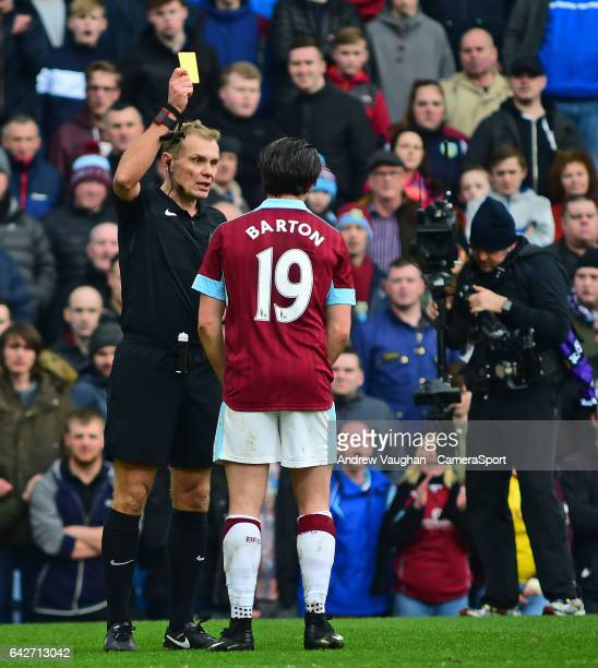 Burnley's Joey Barton is shown a yellow card by referee Graham Scott during The Emirates FA Cup Fifth Round match between Burnley and Lincoln City at...