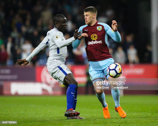 Burnley's Johann Gudmundsson battles with Chelsea's Ngolo Kante during the Premier League match between Burnley and Chelsea at Turf Moor on April 19...