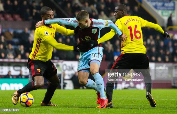 Burnley's Johann Gudmundsson battles with Watford's Christian Kabasele and Abdoulaye Doucoure during the Premier League match between Burnley and...
