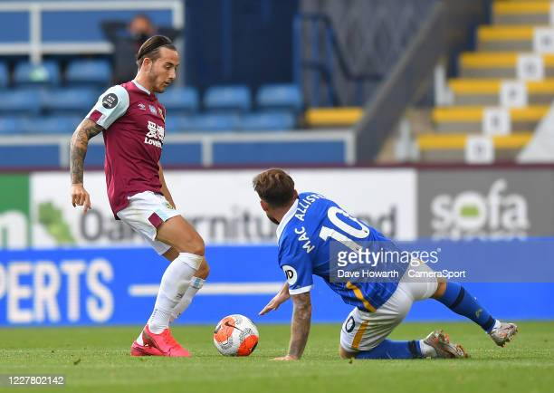 BURNLEY ENGLAND JULY Burnley's Josh Brownhill battles with Brighton Hove Albion's Alexis Mac Allister during the Premier League match between Burnley...