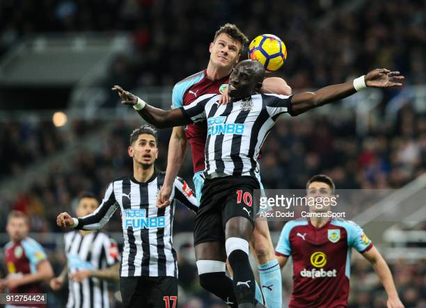 Burnley's Kevin Long battles with Newcastle United's Mohamed Diame during the Premier League match between Newcastle United and Burnley at St James...