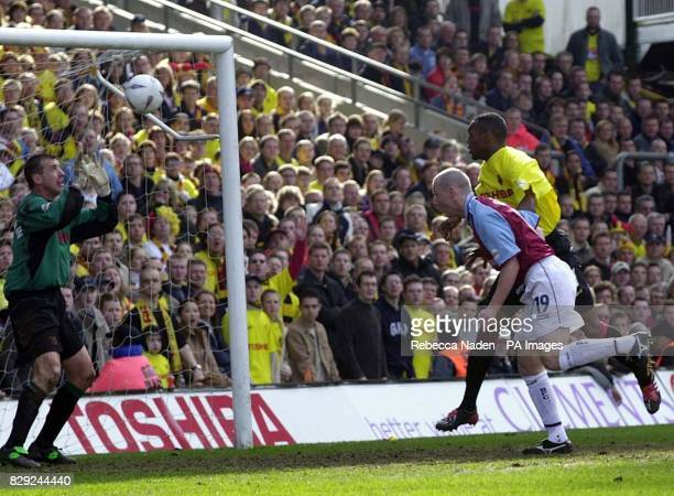 Burnley's Lee Briscoe heads towards Watford goalkeeper Alec Chamberlain during their FA Cup 6th round match at Watford's Vicarage Road ground THIS...