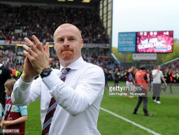 Burnley's manager Sean Dyche celebrates after his side win promotion to the Premier League during the Sky Bet Championship match at Turf Moor Burnley