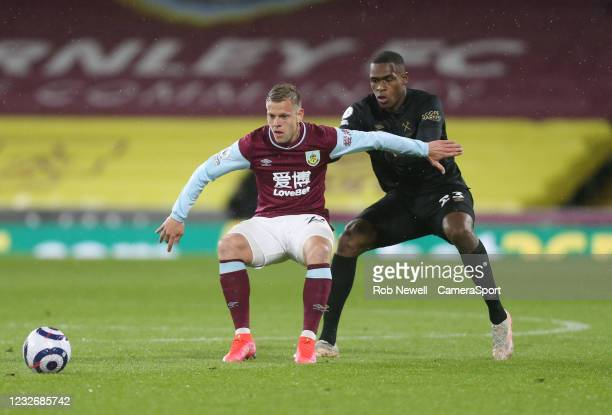 Burnley's Matej Vydra and West Ham United's Issa Diop during the Premier League match between Burnley and West Ham United at Turf Moor on May 3, 2021...