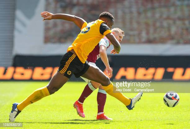 Burnley's Matej Vydra takes on Wolverhampton Wanderers' Willy Boly during the Premier League match between Wolverhampton Wanderers and Burnley at...