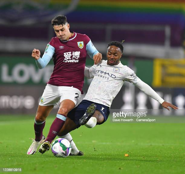Burnley's Matthew Lowton battles with Manchester City's Raheem Sterling during the Carabao Cup fourth round match between Burnley and Manchester City...