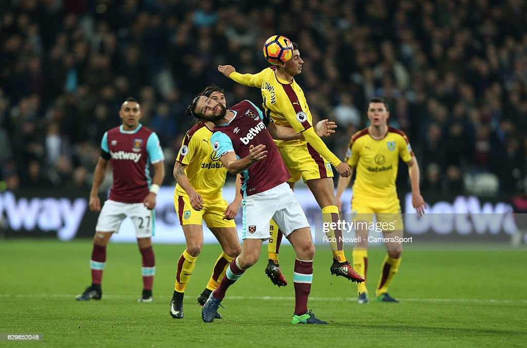 Burnley's Matthew Lowton gets the better of West Ham United's Andy Carroll during the Premier League match between West Ham United and Burnley at London Stadium on December 14, 2016 in Stratford, England.