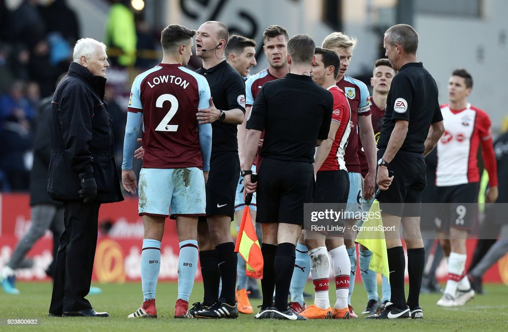 Burnley's Matthew Lowton is calmed by referee Bobby Madley at the final whistle during the Premier League match between Burnley and Southampton at Turf Moor on February 24, 2018 in Burnley, England.
