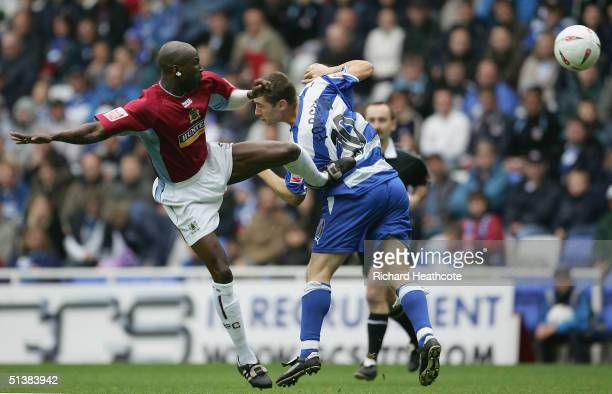 Burnley's Mohammed Camara kicks Reading's Nicky Forster in a challenge during the CocaCola Championship match between Reading and Burnley at Madejski...