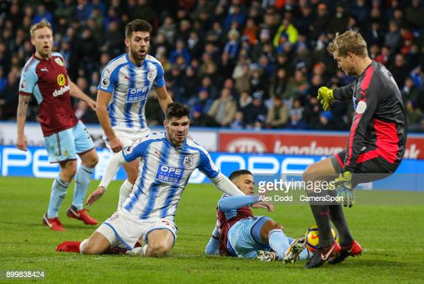 Burnley's Nahki Wells can't beat Huddersfield Town's Jonas Lossl in the closing stages during the Premier League match between Huddersfield Town and...