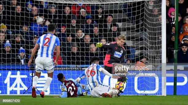 Burnley's Nahki Wells has a shot on goal saved by Huddersfield Town goalkeeper Jonas Lossl during the Premier League match at John Smith's Stadium...