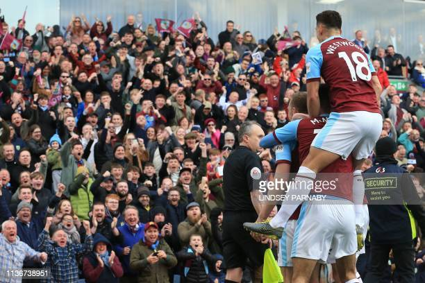 Burnley's New Zealand striker Chris Wood and teammates celebrate with their fans after Wood scores the opening goal of the English Premier League...