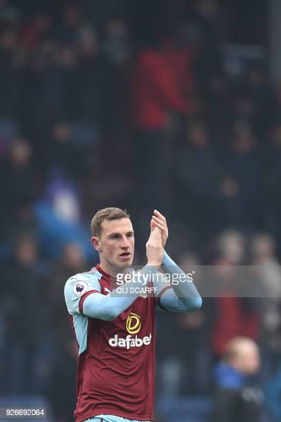 Burnley's New Zealand striker Chris Wood applauds supporters on the pitch after the English Premier League football match between Burnley and Everton...