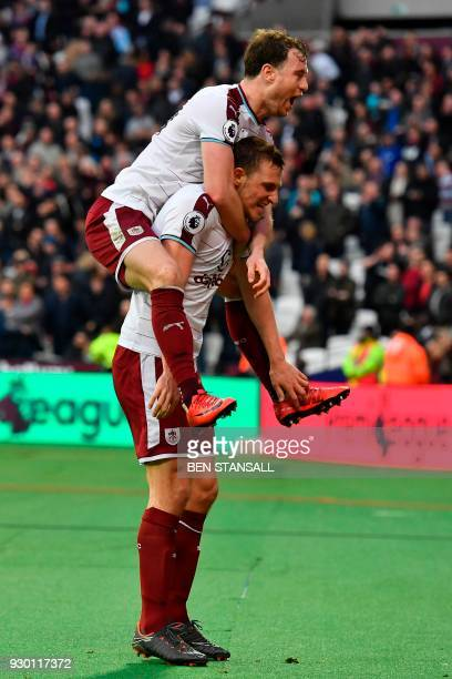 Burnley's New Zealand striker Chris Wood celebrates scoring a goal with Burnley's English striker Ashley Barnes during the English Premier League...