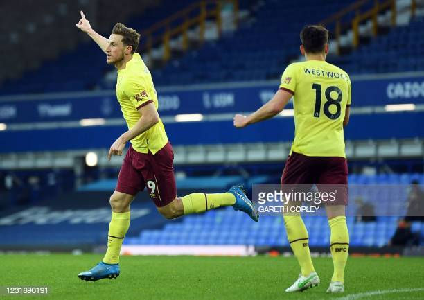 Burnley's New Zealand striker Chris Wood celebrates scoring his team's first goal during the English Premier League football match between Everton...