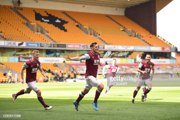 Burnley's New Zealand striker Chris Wood celebrates scoring his team's third goal with teammates during the English Premier League football match...