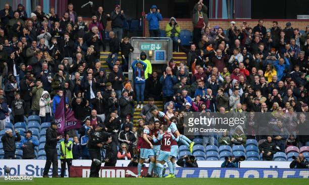 Burnley's New Zealand striker Chris Wood celebrates scoring his team's first goal with teammates Burnley's Irish defender Stephen Ward Burnley's...
