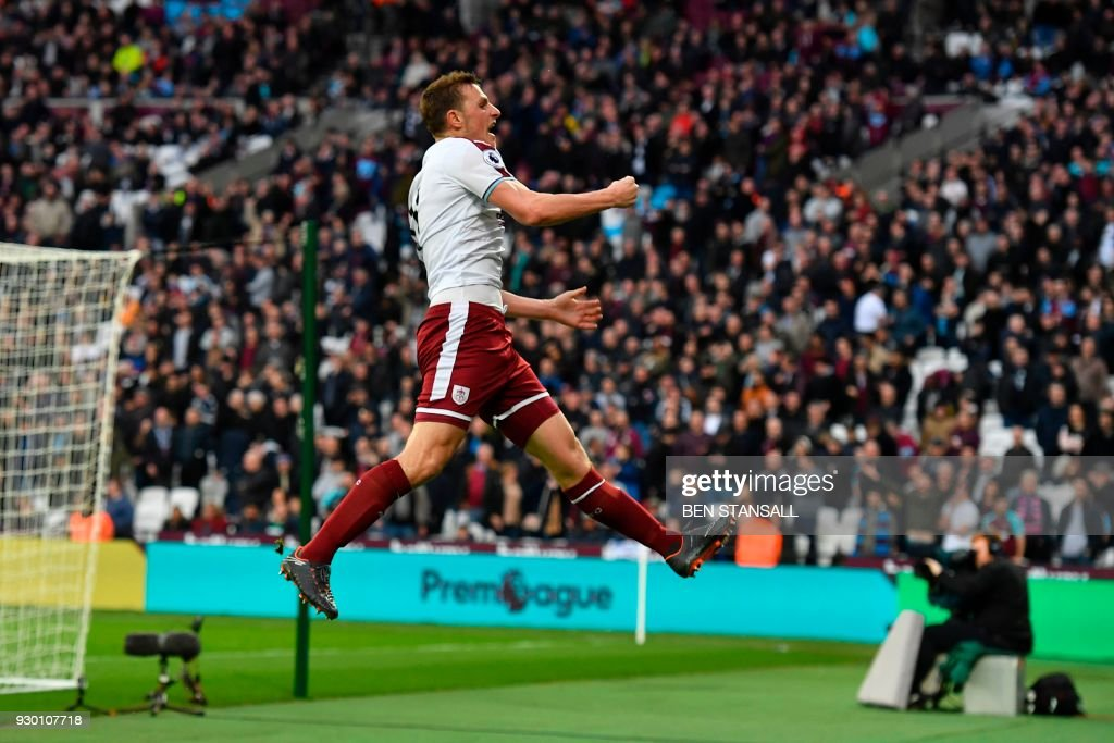 TOPSHOT - Burnley's New Zealand striker Chris Wood celebrates scoring their third goal during the English Premier League football match between West Ham United and Burnley at The London Stadium, in east London on March 10, 2018. / AFP PHOTO / Ben STANSALL / RESTRICTED TO EDITORIAL USE. No use with unauthorized audio, video, data, fixture lists, club/league logos or 'live' services. Online in-match use limited to 75 images, no video emulation. No use in betting, games or single club/league/player publications. /