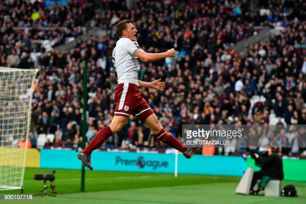 TOPSHOT Burnley's New Zealand striker Chris Wood celebrates scoring their third goal during the English Premier League football match between West...