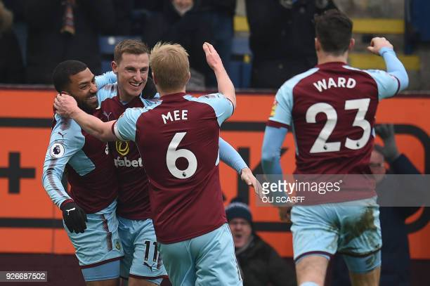 Burnley's New Zealand striker Chris Wood celebrates with teammates after scoring their second goal during the English Premier League football match...