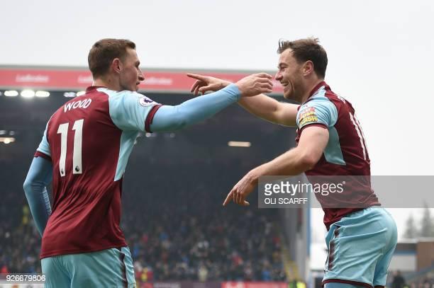 Burnley's New Zealand striker Chris Wood congratulates Burnley's English striker Ashley Barnes on scoring their first goal during the English Premier...