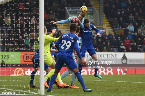 Burnley's New Zealand striker Chris Wood jumps to head home their second goal during the English Premier League football match between Burnley and...