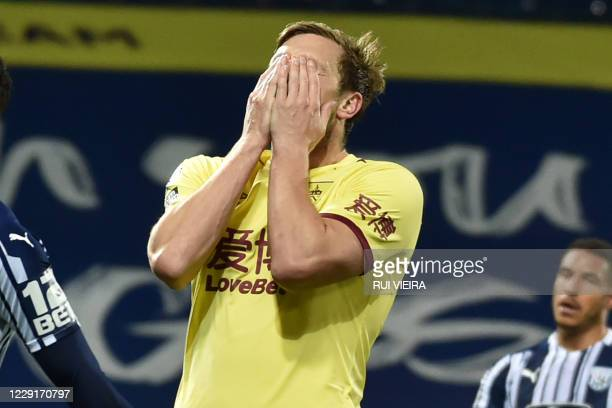 Burnley's New Zealand striker Chris Wood reacts after missing a good chance during the English Premier League football match between West Bromwich...