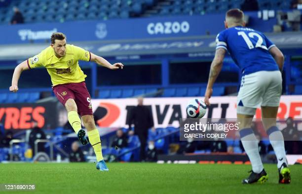 Burnley's New Zealand striker Chris Wood scores the opening goal during the English Premier League football match between Everton and Burnley at...