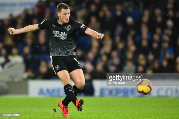 Burnley's New Zealand striker Chris Wood shoots to score the opening goal of the English Premier League football match between Brighton and Hove...