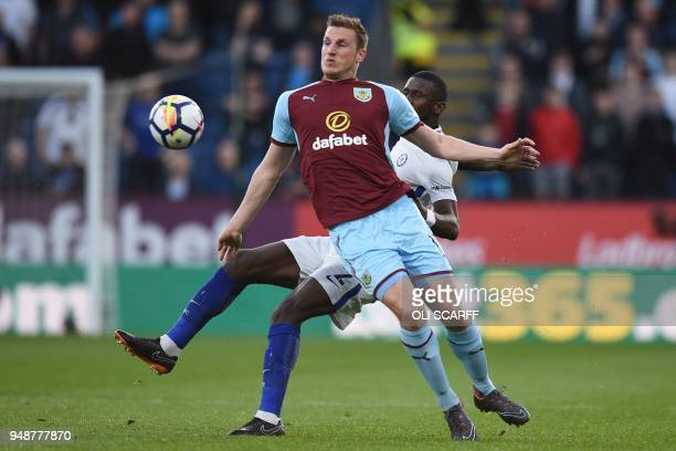 Burnley's New Zealand striker Chris Wood vies with Chelsea's German defender Antonio Rudiger during the English Premier League football match between...