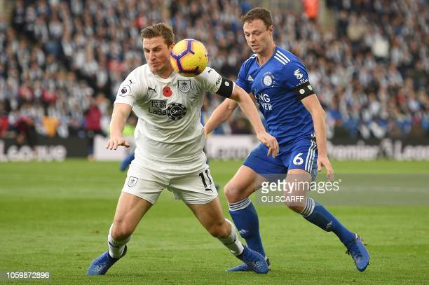 Burnley's New Zealand striker Chris Wood vies with Leicester City's Northern Irish defender Jonny Evans during the English Premier League football...