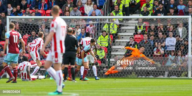 Burnley's Nick Pope can't keep out the shot from Stoke City's Papa Alioune Ndiaye during the Premier League match between Stoke City and Burnley at...