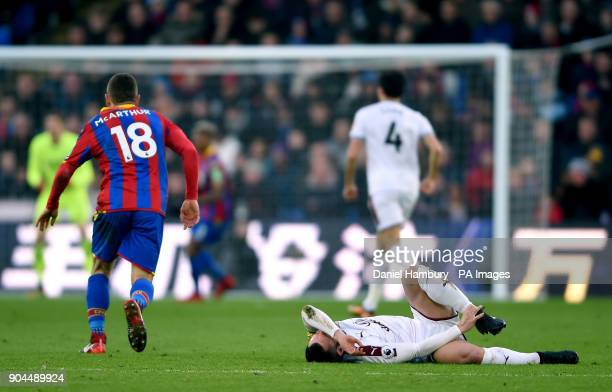 Burnley's Phil Bardsley reacts to a challenge from Crystal Palace's James McArthur during the Premier League match at Selhurst Park London