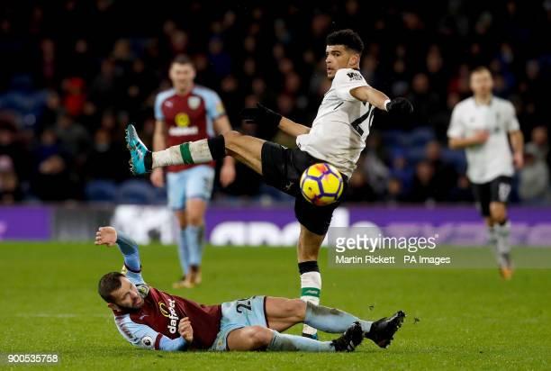 Burnley's Phil Bardsley slides in on Liverpool's Dominic Solanke