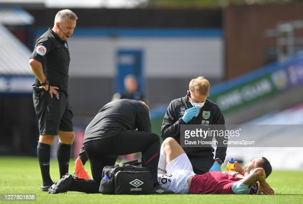 Burnley's Phillip Bardsley receives treatment during the Premier League match between Burnley FC and Brighton Hove Albion at Turf Moor on July 26...