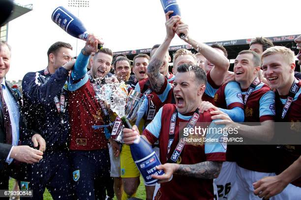 Burnley's players celebrate with champagne after winning promotion and finishing 2014 runners up after the Burnley v Ipswich match at Turf Moor