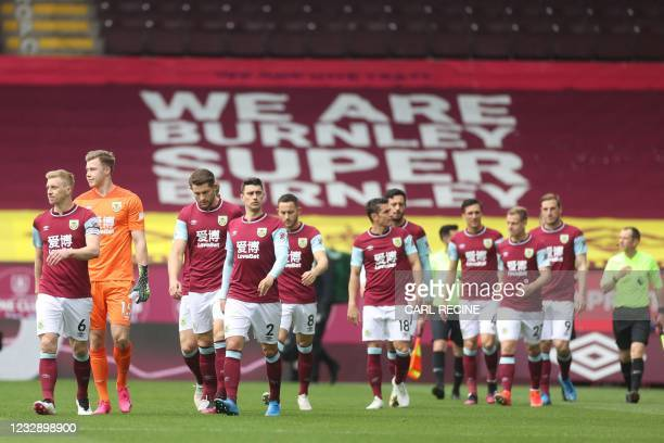 Burnley's players walk onto the pitch ahead of the English Premier League football match between Burnley and Leeds United at Turf Moor in Burnley,...