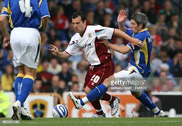 Burnley's Robbie Blake and Cardiff City's Kevin McNaughton battle for the ball
