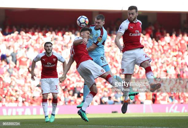 Burnley's Sam Vokes and Arsenal's Konstantinos Mavropanos battle for the ball during the Premier League match at the Emirates Stadium London