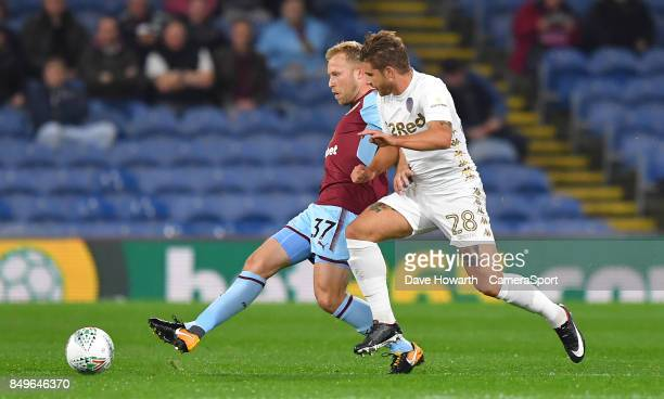 Burnley's Scott Arfield holds off Leeds United's Gaetano Berardi during the Carabao Cup Third Round match between Burnley and Leeds United at Turf...
