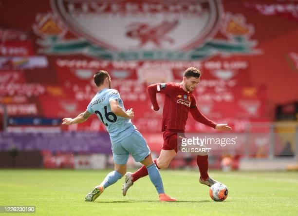 Burnley's Scottish defender Phil Bardsley challenges Liverpool's Scottish defender Andrew Robertson during the English Premier League football match...