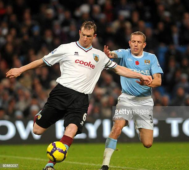 Burnley's Scottish defender Steven Caldwell vies with Manchester City's Welsh striker Craig Bellamy during the English Premier League football match...